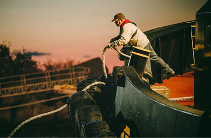 Man working on a boat in the marine industry
